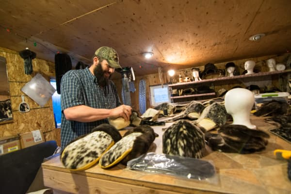 Based in Sitka, Robert Miller makes one-of-a-kind hats and gloves from local animal furs. Also a fisheries biologist for the government, Miller hopes his business will offset any potential budget cutbacks.